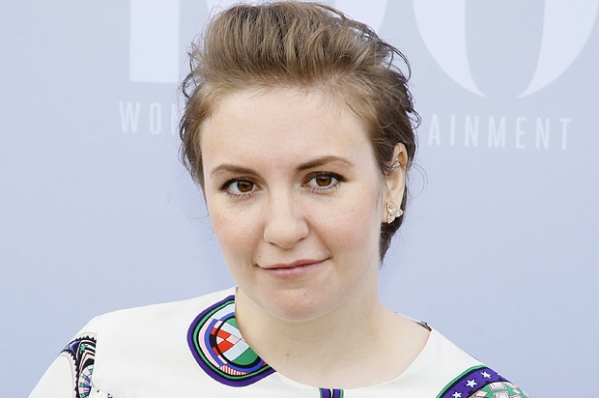 Actress Lena Dunham poses at The Hollywood Reporter's Annual Women in Entertainment Breakfast in Los Angeles