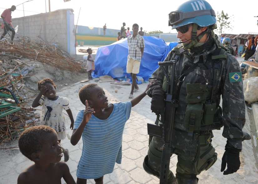 United Nations peacekeeper with Hatian children